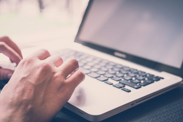 close-up-hands-multitasking-man-using-laptop-connecting-wifi