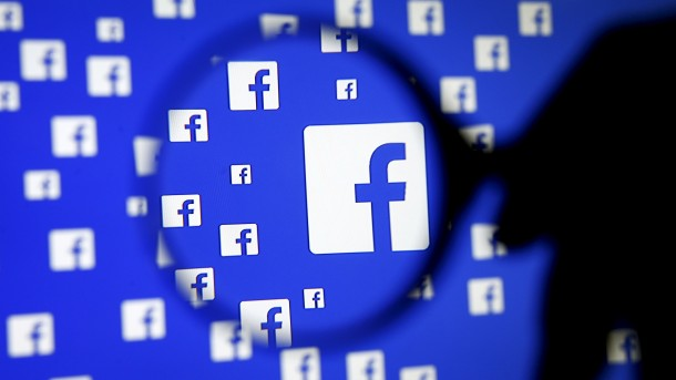 """A man poses with a magnifier in front of a Facebook logo on display in this illustration taken in Sarajevo, Bosnia and Herzegovina, December 16, 2015.   REUTERS/Dado Ruvic/Illustration/File Photo   GLOBAL BUSINESS WEEK AHEAD PACKAGE - SEARCH """"BUSINESS WEEK AHEAD JULY 25"""" FOR ALL IMAGES - RTSJGEL"""