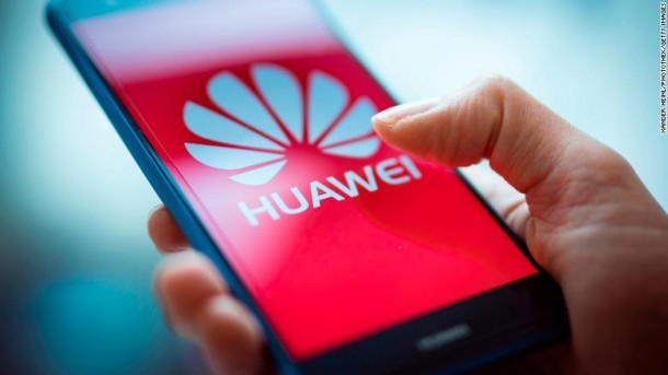 BERLIN, GERMANY - JANUARY 15:  A Woman holding a mobile device with a Huawei logo is seen in this photo illustration on January 15, 2019.(Photo by Xander Heinl/Photothek via Getty Images)